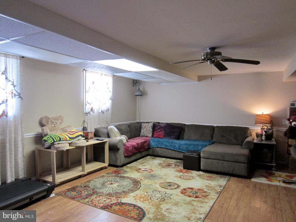 Lower level family room - 81 ESTATE ROW, STAFFORD