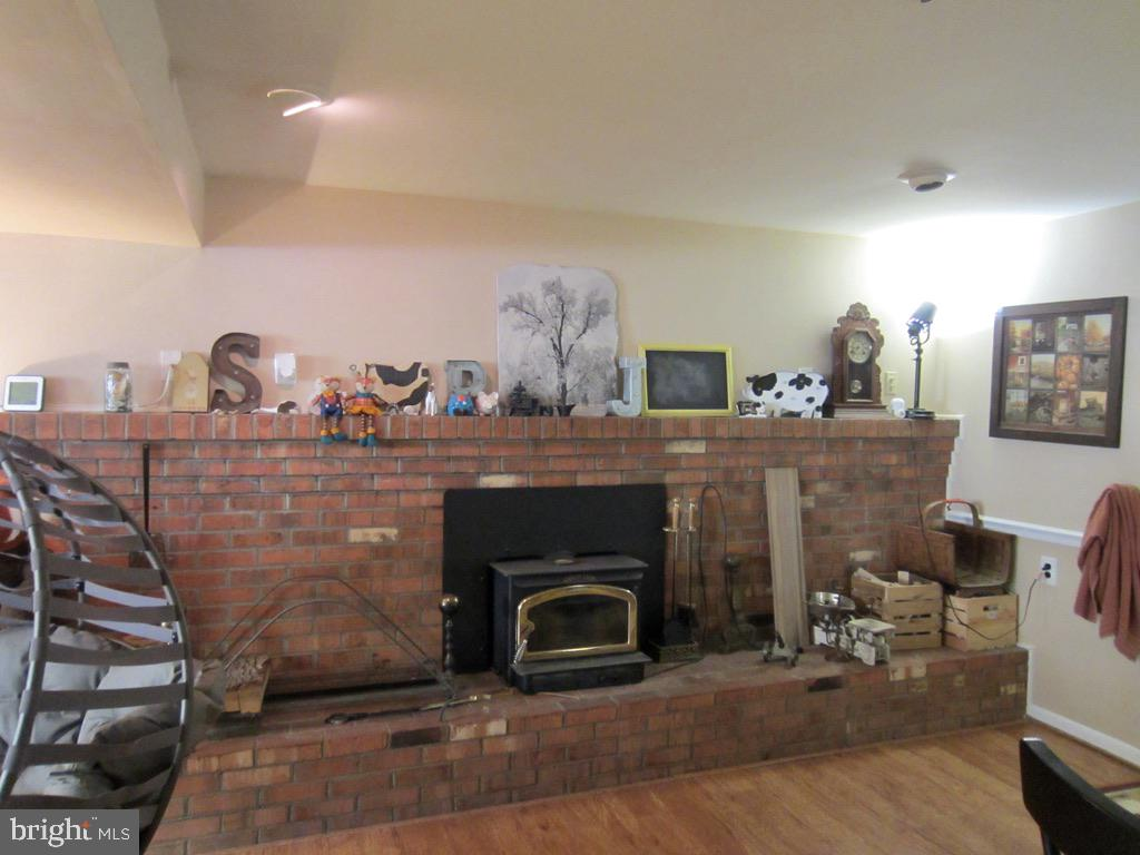 Mantle and wood stove - 81 ESTATE ROW, STAFFORD