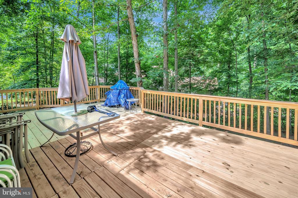 wood views from raised deck - 201 HAPPY CREEK RD, LOCUST GROVE