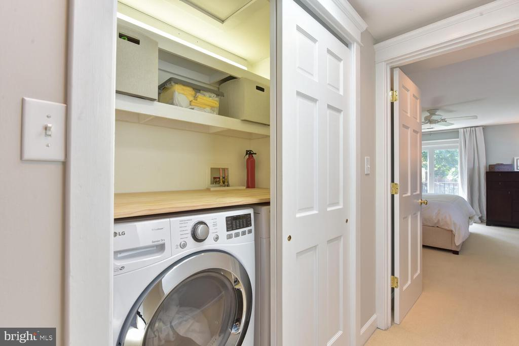 Upper level laundry with shelving and folding top - 3302 ELMORE DR, ALEXANDRIA