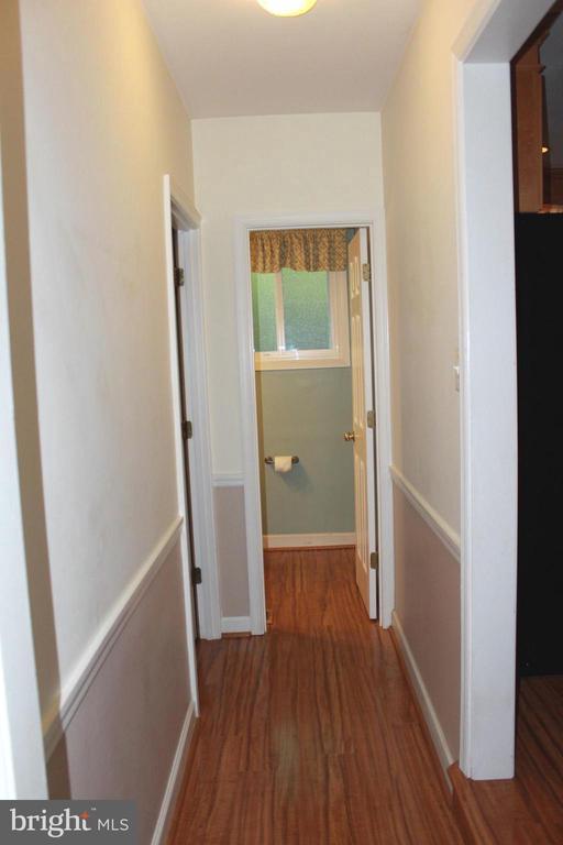 Hall to powder room - 8503 QUEEN ELIZABETH BLVD, ANNANDALE