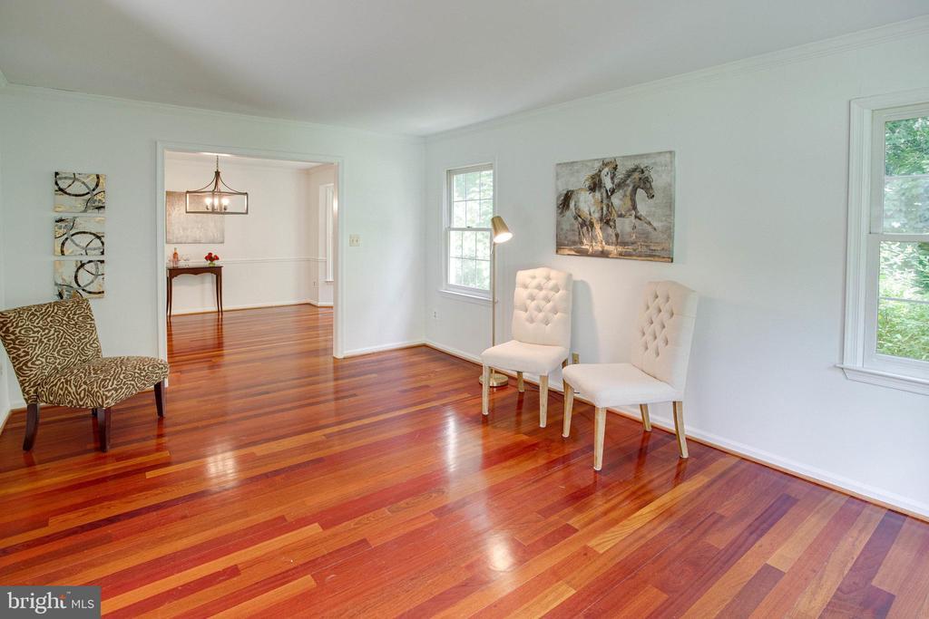 The living room has brazillian cherry floors. - 320 DESTROYER CV, STAFFORD