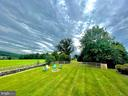Large fenced in backyard with firepit - 14868 CIDER MILL RD, HILLSBORO