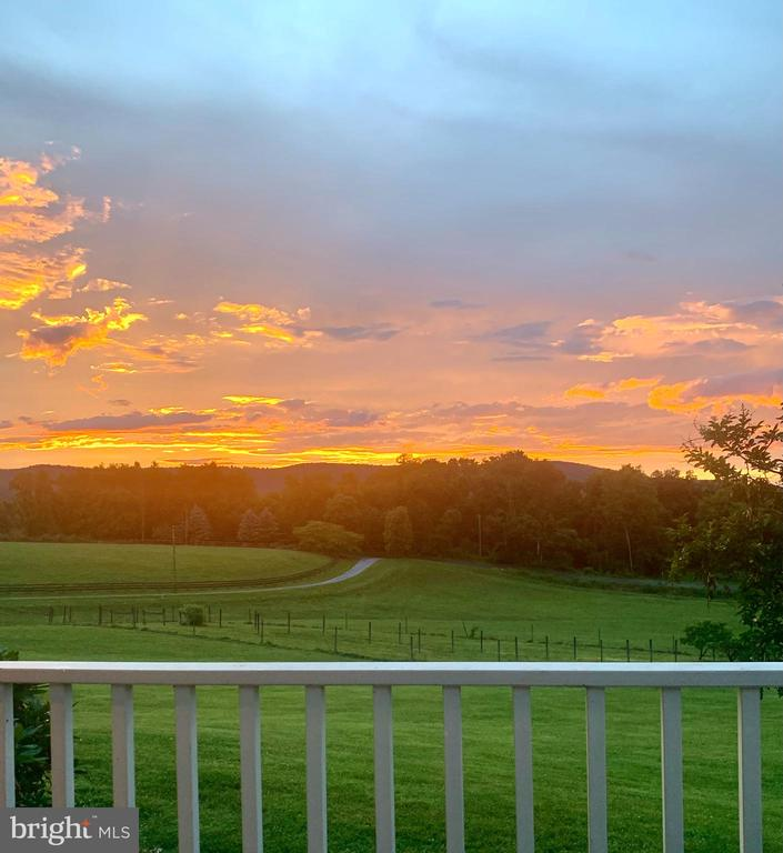 Sunset after the rains.  Porch view - 14868 CIDER MILL RD, HILLSBORO