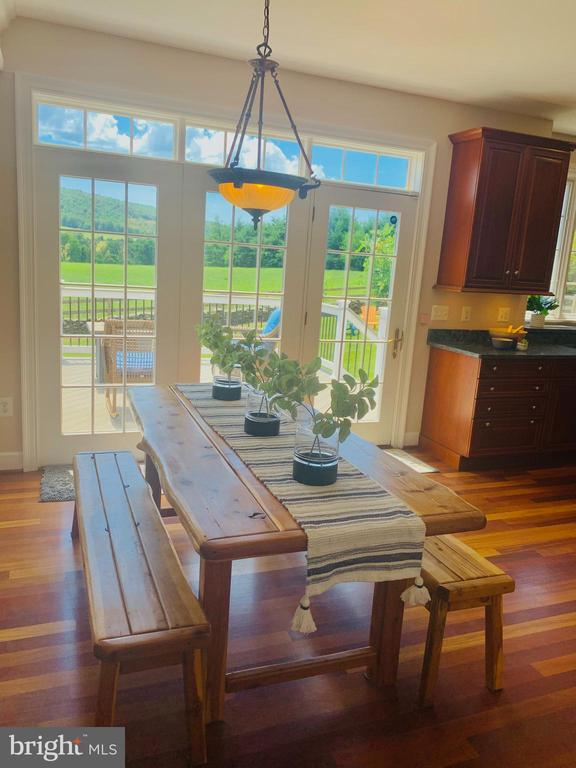 Breakfast area overlooking deck and acres of green - 14868 CIDER MILL RD, HILLSBORO