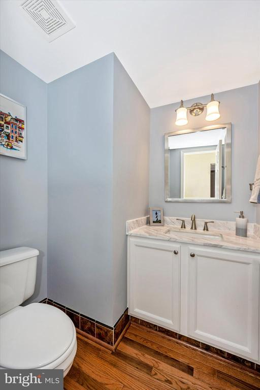 Main floor half bath with updated vanity - 6304 SPRING FOREST RD, FREDERICK