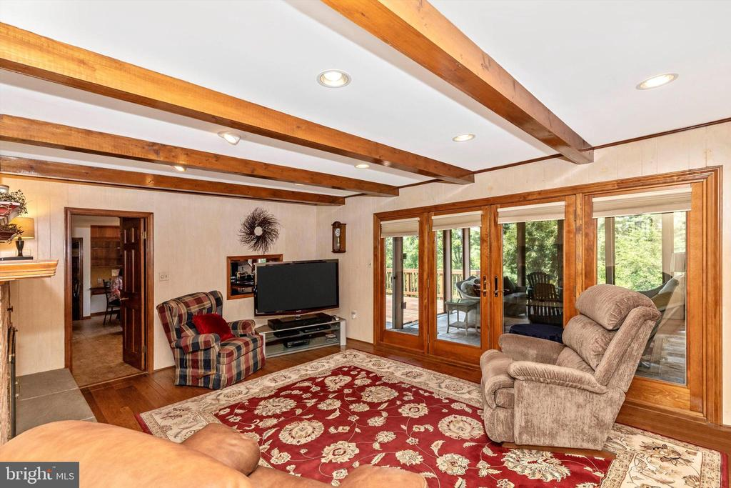 Main Level Family Room with Fireplace - 7402 ROUND HILL RD, FREDERICK