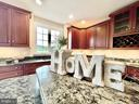 Gleaming wood cabinets and floors, custom kitchen - 14868 CIDER MILL RD, HILLSBORO