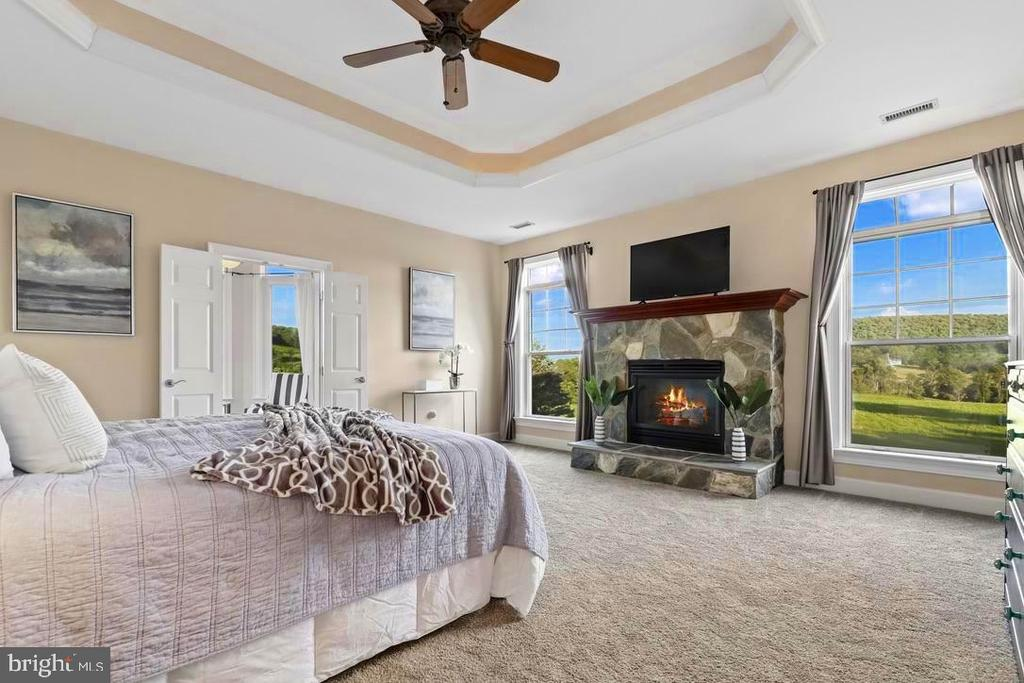 Primary Bedroom with tray ceiling - 14868 CIDER MILL RD, HILLSBORO