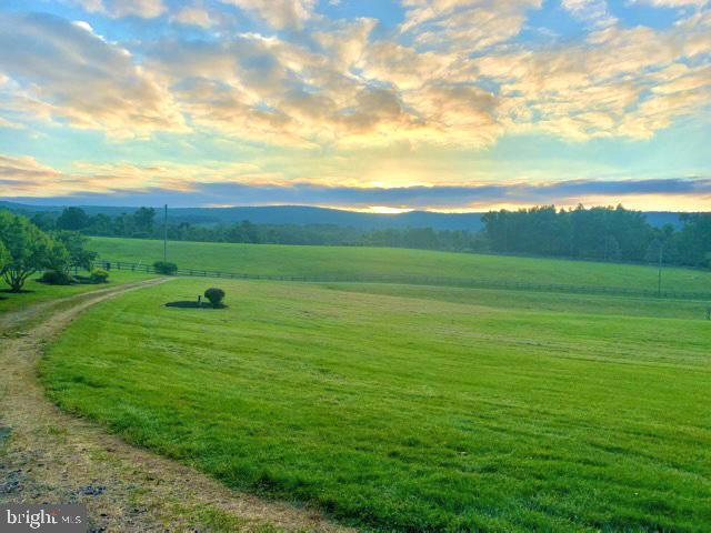 Mesmerizing sunsets from your porch - 14868 CIDER MILL RD, HILLSBORO