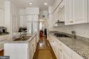 Kitchen with island - 8619 TERRACE GARDEN WAY, BETHESDA