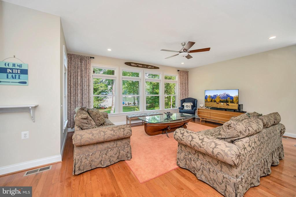 view from dining area to family room - 108 BEACHSIDE CV, LOCUST GROVE