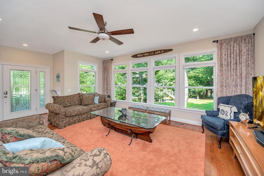Window Wall family room with wood floors - 108 BEACHSIDE CV, LOCUST GROVE