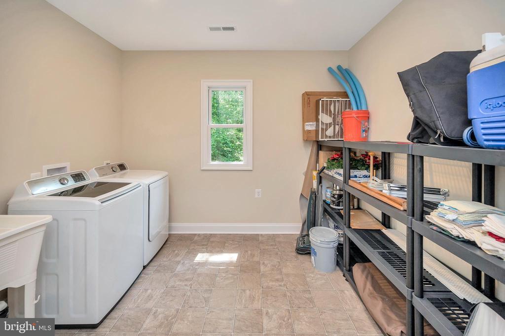 coveted upper level laundry -utility sink-storage - 108 BEACHSIDE CV, LOCUST GROVE