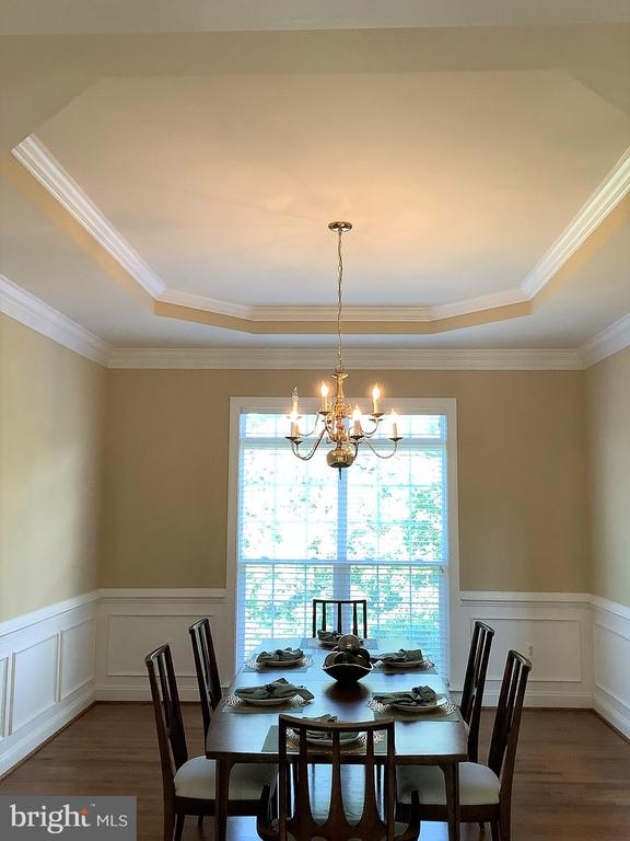 Elegant Dining Room with Moldings and Tray Ceiling - 22554 FOREST RUN DR, ASHBURN