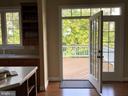 Gourmet kitchen opens to deck - 22554 FOREST RUN DR, ASHBURN