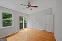 Primary bedroom with deck - 8017 GALLA KNOLL CIR, SPRINGFIELD