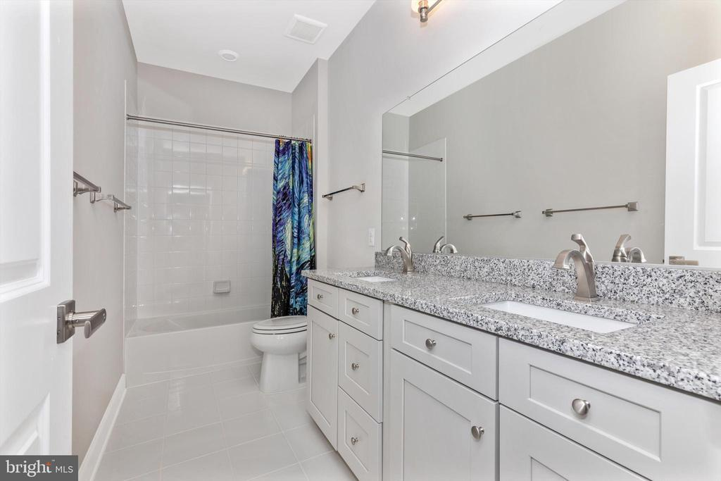 Upper level bathroom with dual vanity - 3835 FULHAM RD, FREDERICK