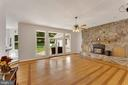 Hardwood floors and a stone fireplace - 4346 BASFORD RD, FREDERICK