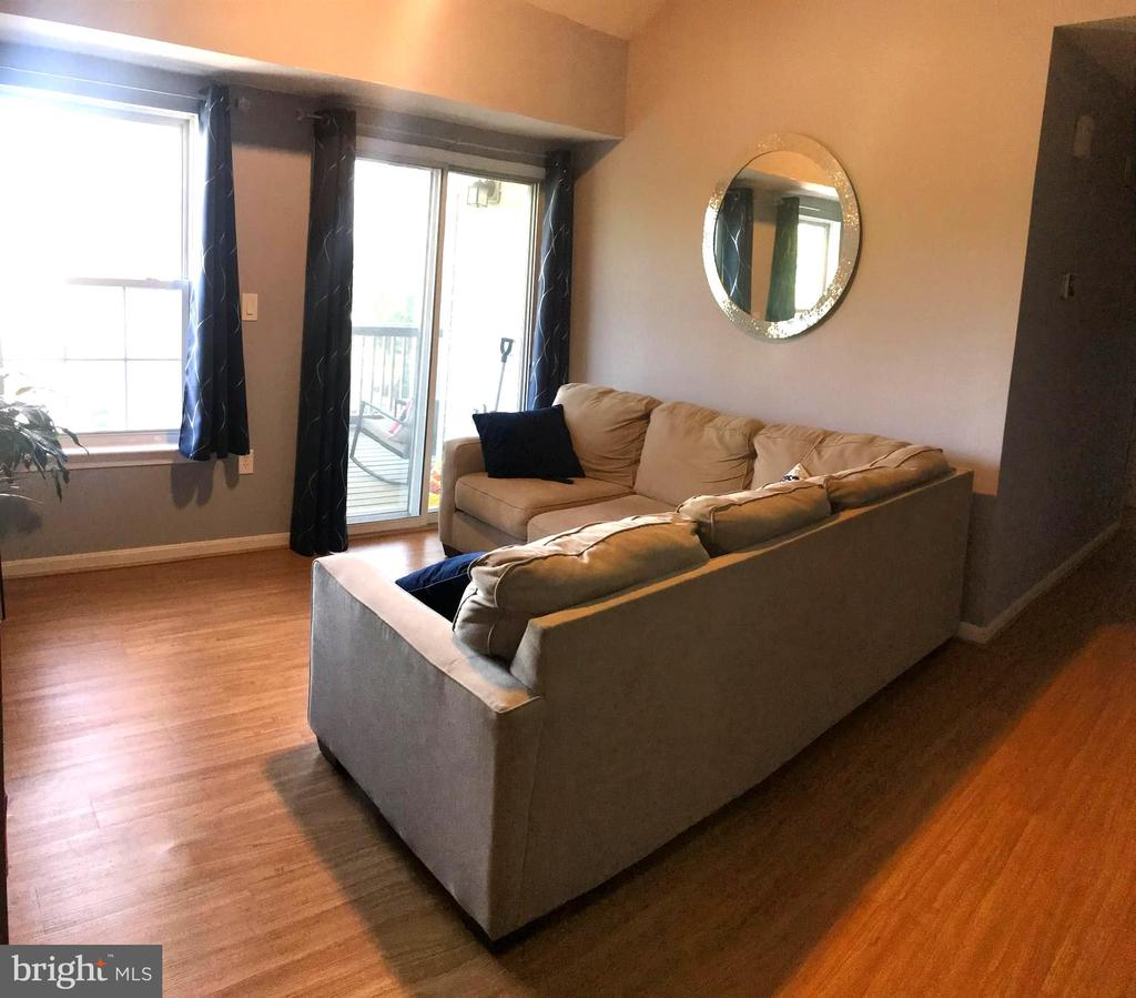 Living Room with access to screened in porch - 6502 LAKE PARK DR #301, GREENBELT
