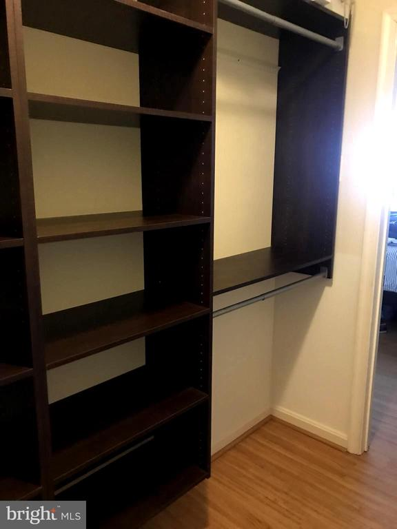Walk in closet with built-ins - 6502 LAKE PARK DR #301, GREENBELT