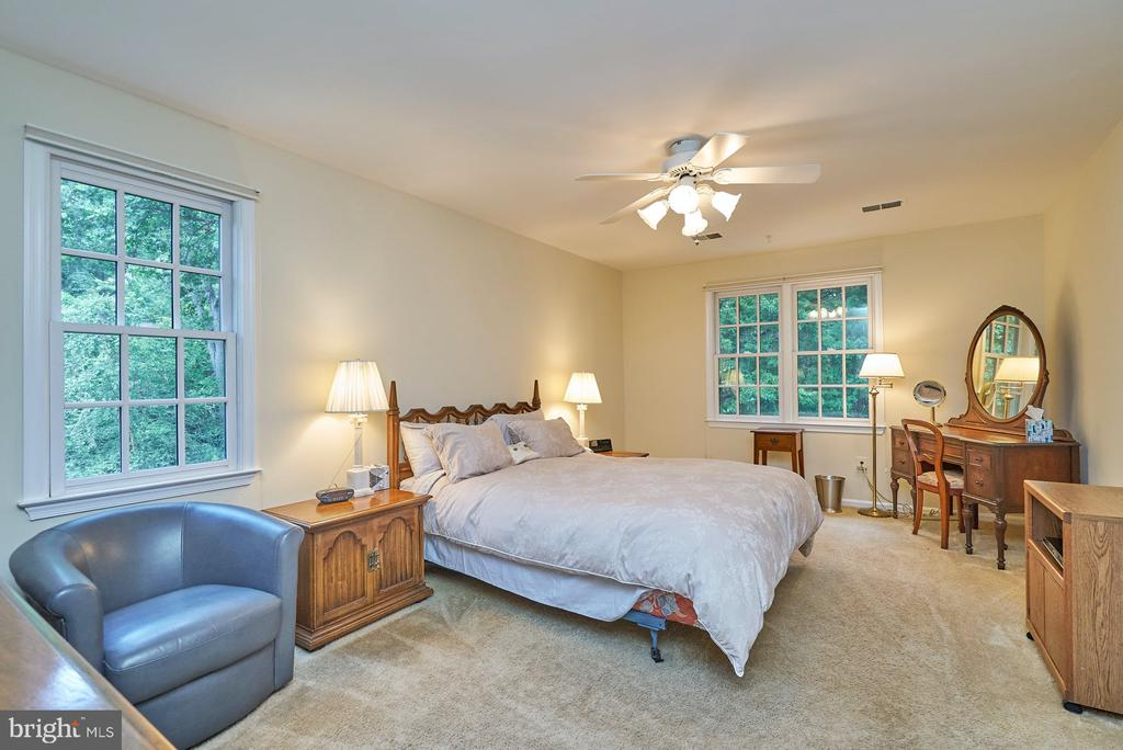 Primary Bedroom with Lighted Ceiling Fan - 11902 HOLLY SPRING DR, GREAT FALLS