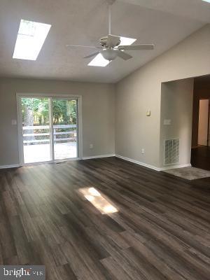 Family Room with new luxury vinyl flooring - 315 LIMESTONE LN, LOCUST GROVE