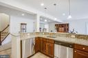 Lower level kitchen with fridge and dishwasher - 57 SNAPDRAGON DR, STAFFORD