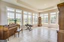 Sunroom with tiled floor, look at all the windows - 57 SNAPDRAGON DR, STAFFORD