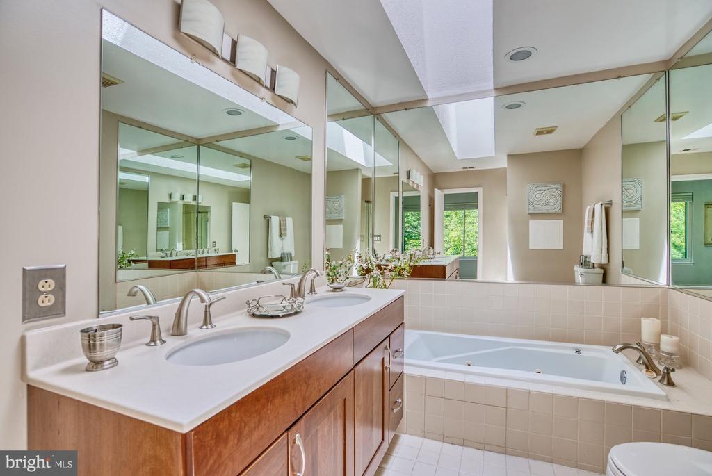 Primary Bathroom has custom vanity - 2211 CEDAR COVE CT, RESTON