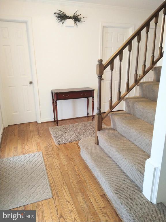 Foyer, Hardwood Floor and Bottom of Stairs - 13600 BRIDGELAND LN, CLIFTON