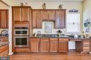 Kitchen with stainless Steel appliances - 17451 LETHRIDGE CIR, ROUND HILL