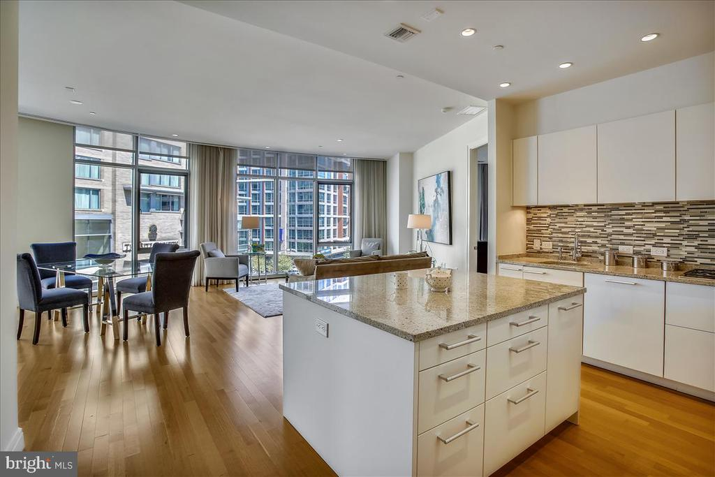 Open floor plan. Primary bedroom on the right. - 1177 22ND ST NW #4M, WASHINGTON