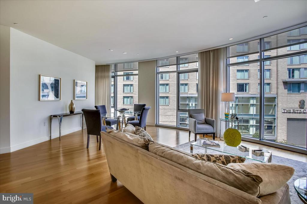 Full wall of floor to ceiling windows. - 1177 22ND ST NW #4M, WASHINGTON
