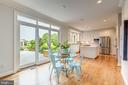 kitchen access to large deck for entertaining - 22606 HILLSIDE CIR, LEESBURG