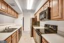 There is plenty of counter space for cooking - 12236 LADYMEADE CT #5-201, WOODBRIDGE