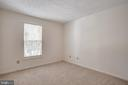The guest bedroom is spacious - 12236 LADYMEADE CT #5-201, WOODBRIDGE