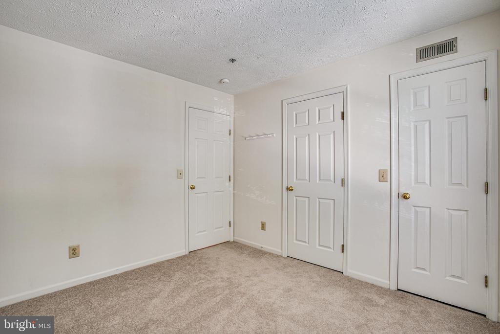 Guest bedroom has a sizable closet - 12236 LADYMEADE CT #5-201, WOODBRIDGE