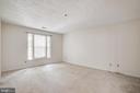 The primary bedroom is huge! - 12236 LADYMEADE CT #5-201, WOODBRIDGE