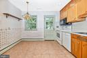 Kitchen opens to the patio - 703 WYNGATE DR, FREDERICK