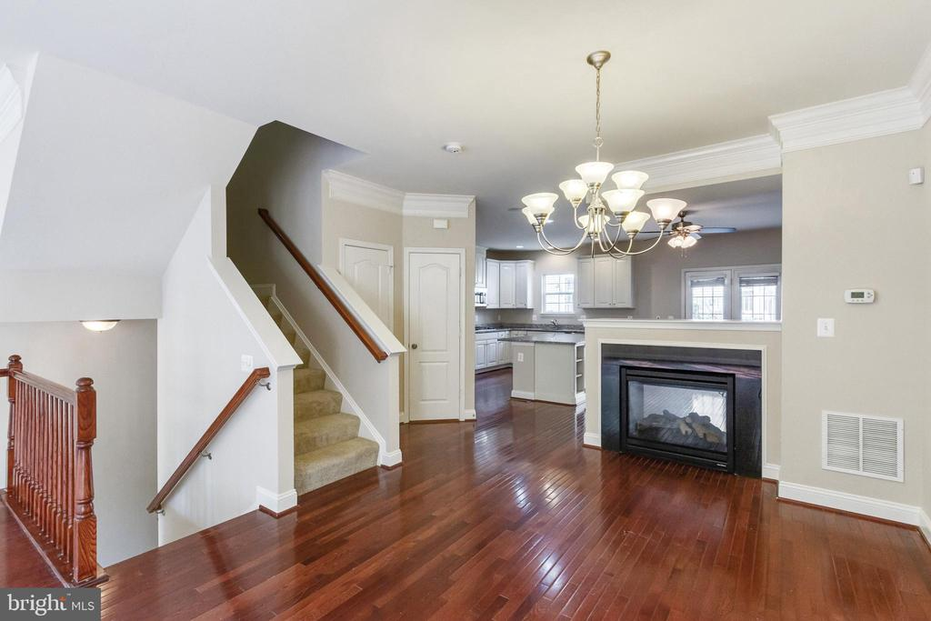 Dining Room with 2-Sided Gas Fireplace - 4807 POTOMAC HIGHLANDS CIR, TRIANGLE