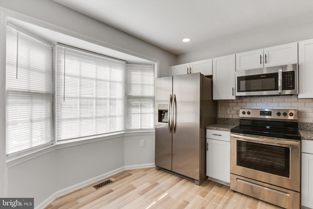 Kitchen with Stainless Steel Appliances - 11572 OVERLEIGH DR, WOODBRIDGE