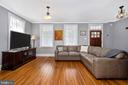 Living room features vintage hardwood floors - 123 W 5TH ST, FREDERICK