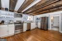 Kitchen features open shelving - 123 W 5TH ST, FREDERICK