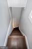 Rear staircase to main level laundry - 123 W 5TH ST, FREDERICK