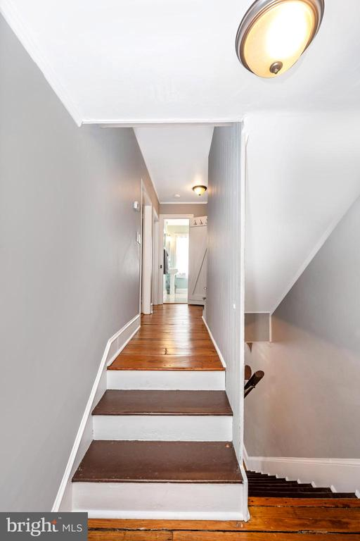 Hallway to  second and third bedrooms and bath - 123 W 5TH ST, FREDERICK