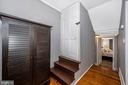 Upper level hall with door to unfinished attic. - 123 W 5TH ST, FREDERICK