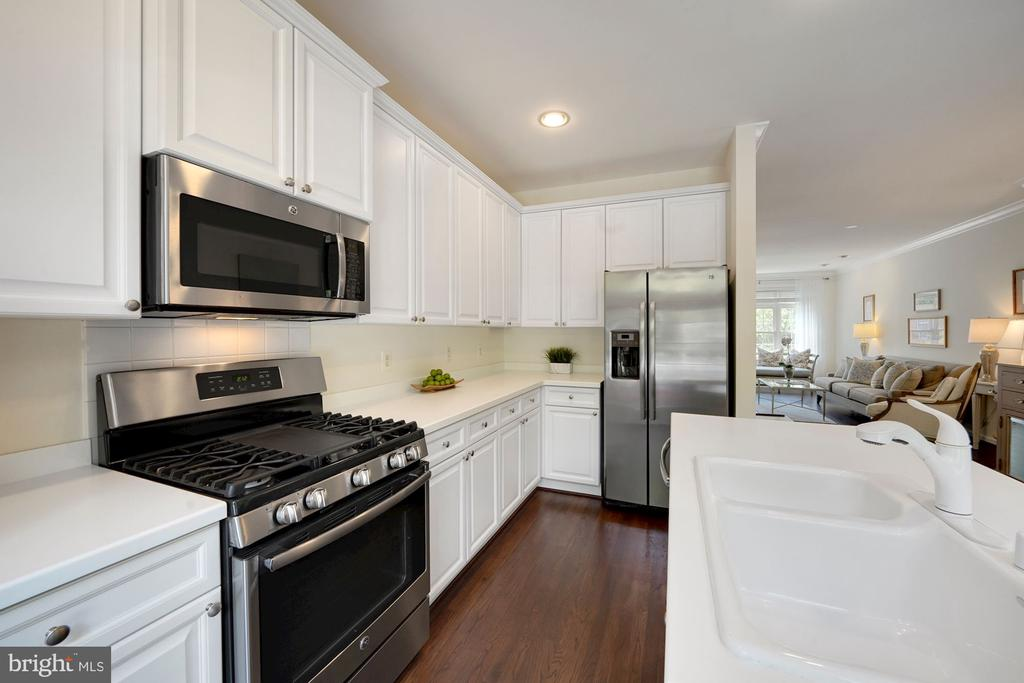 Kitchen with Corian Countes & Newer SS Appliances - 12079 CHANCERY STATION CIR, RESTON