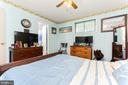 Primary bedroom with access to full bath. - 4800 FLOWER LN, ALEXANDRIA