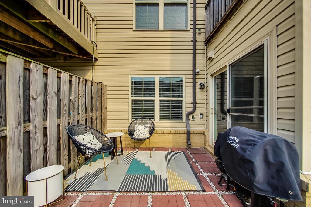 Patio opens to privacy fenced yard - 23636 SAILFISH SQ, BRAMBLETON